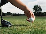 Placing a golf ball on the tee Stock Photo - Premium Royalty-Free, Artist: Aflo Sport, Code: 6114-06607895