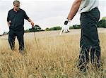 Two golfers in long grass Stock Photo - Premium Royalty-Free, Artist: Blend Images, Code: 6114-06607902