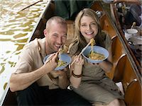 Couple eating meal on river boat Stock Photo - Premium Royalty-Freenull, Code: 6114-06608037