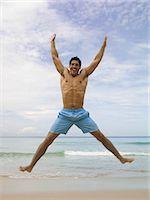 shirtless men - Man jumping by the sea Stock Photo - Premium Royalty-Freenull, Code: 6114-06608052