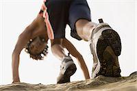 rock climber - Man running on rocks Stock Photo - Premium Royalty-Freenull, Code: 6114-06608095