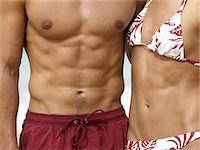 Healthy couple wearing swimwear Stock Photo - Premium Royalty-Freenull, Code: 6114-06608216