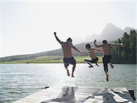 Family jumping into fijord Stock Photo - Premium Royalty-Freenull, Code: 6114-06608348