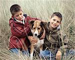 Brother hugging dog Stock Photo - Premium Royalty-Free, Artist: CulturaRM, Code: 6114-06608367