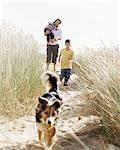 Family walking down a dune Stock Photo - Premium Royalty-Free, Artist: CulturaRM, Code: 6114-06608374