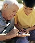 Grandfather and grandson looking at shells Stock Photo - Premium Royalty-Free, Artist: CulturaRM, Code: 6114-06608400