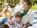 Father and son lying on a blanket Stock Photo - Premium Royalty-Free, Artist: CulturaRM, Code: 6114-06608408