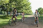 Family riding bicycles Stock Photo - Premium Royalty-Freenull, Code: 6114-06608432