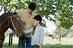 Father and daughter horseback riding Stock Photo - Premium Royalty-Free, Artist: CulturaRM, Code: 6114-06608444