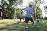 Father and son playing football Stock Photo - Premium Royalty-Free, Artist: Blend Images, Code: 6114-06608454