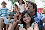 Families relaxing outdoors Stock Photo - Premium Royalty-Free, Artist: Blend Images, Code: 6114-06608456