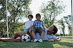 Boys sitting on top of dad Stock Photo - Premium Royalty-Free, Artist: Blend Images, Code: 6114-06608459