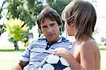 Boy with football talking to man Stock Photo - Premium Royalty-Free, Artist: CulturaRM, Code: 6114-06608462