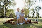 Boys sitting on top of dad Stock Photo - Premium Royalty-Free, Artist: Blend Images, Code: 6114-06608465