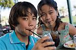 Brother and sister drinking cola Stock Photo - Premium Royalty-Free, Artist: Blend Images, Code: 6114-06608565