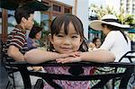 Girl with family at restaurant Stock Photo - Premium Royalty-Free, Artist: Blend Images, Code: 6114-06608570