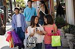 Girls and family shopping Stock Photo - Premium Royalty-Free, Artist: Michael Mahovlich, Code: 6114-06608580