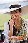 Woman eating meal Stock Photo - Premium Royalty-Free, Artist: Glowimages, Code: 6114-06608592