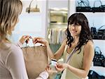 Woman shopping Stock Photo - Premium Royalty-Free, Artist: Blend Images, Code: 6114-06608608