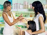 Shop assistant with mother and daughter Stock Photo - Premium Royalty-Free, Artist: Uwe Umstätter, Code: 6114-06608646
