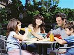Family at a cafe outdoors Stock Photo - Premium Royalty-Free, Artist: Blend Images, Code: 6114-06608652