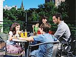 Family at a cafe outdoors Stock Photo - Premium Royalty-Free, Artist: Glowimages, Code: 6114-06608660