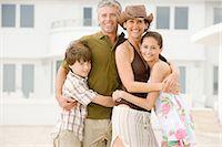 Family hugging Stock Photo - Premium Royalty-Freenull, Code: 6114-06608663