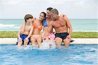 Family by the pool Stock Photo - Premium Royalty-Freenull, Code: 6114-06608665