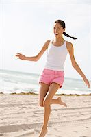 Girl running on the beach Stock Photo - Premium Royalty-Freenull, Code: 6114-06608676