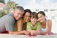 Family on the beach Stock Photo - Premium Royalty-Freenull, Code: 6114-06608698