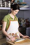Woman preparing food in kitchen Stock Photo - Premium Royalty-Free, Artist: Kablonk! RM, Code: 6114-06608775