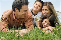 family  fun  outside - Family lying on meadow Stock Photo - Premium Royalty-Freenull, Code: 6114-06608812