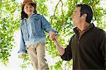 Girl walking on wall holding fathers hand Stock Photo - Premium Royalty-Free, Artist: Cultura RM, Code: 6114-06608813