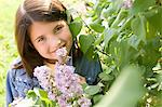 Girl smelling lilac blossoms Stock Photo - Premium Royalty-Free, Artist: Blend Images, Code: 6114-06608814
