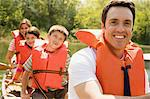 Family wearing life jacket in canoe Stock Photo - Premium Royalty-Free, Artist: Robert Harding Images, Code: 6114-06608825