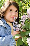 Girl smelling lilac blossoms Stock Photo - Premium Royalty-Free, Artist: Susan Findlay, Code: 6114-06608826