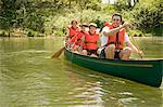Family wearing life jacket in canoe Stock Photo - Premium Royalty-Free, Artist: Robert Harding Images, Code: 6114-06608829