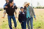 Family walking on field Stock Photo - Premium Royalty-Free, Artist: CulturaRM, Code: 6114-06608835
