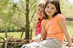 Boy and girl sitting on wooden fence Stock Photo - Premium Royalty-Free, Artist: R. Ian Lloyd, Code: 6114-06608838