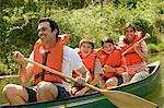 Family wearing life jacket in canoe Stock Photo - Premium Royalty-Free, Artist: AWL Images, Code: 6114-06608856