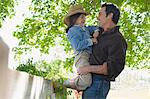 Father lifting daughter Stock Photo - Premium Royalty-Free, Artist: AWL Images, Code: 6114-06608859