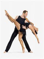 Male dancer holding female dancer Stock Photo - Premium Royalty-Freenull, Code: 6114-06608879