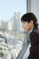 Man looking at the city Stock Photo - Premium Royalty-Freenull, Code: 6114-06608912