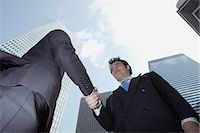 Businessmen shaking hands Stock Photo - Premium Royalty-Freenull, Code: 6114-06608944