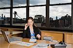 Businesswoman using cell phone Stock Photo - Premium Royalty-Free, Artist: Strauss/Curtis, Code: 6114-06608971