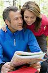 Hiking couple looking at a map Stock Photo - Premium Royalty-Free, Artist: Cultura RM, Code: 6114-06609088