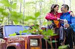 Couple sitting on an automobile hood Stock Photo - Premium Royalty-Free, Artist: Cultura RM, Code: 6114-06609096