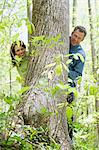 Mature couple standing behind a tree Stock Photo - Premium Royalty-Free, Artist: CulturaRM, Code: 6114-06609097