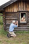Senior couple having fun at log cabin Stock Photo - Premium Royalty-Free, Artist: Cultura RM, Code: 6114-06609171