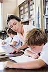 Teacher and pupils Stock Photo - Premium Royalty-Free, Artist: Westend61, Code: 6114-06609204